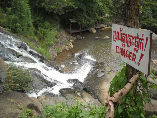 Read the sign! Waterfall outside Pailin.