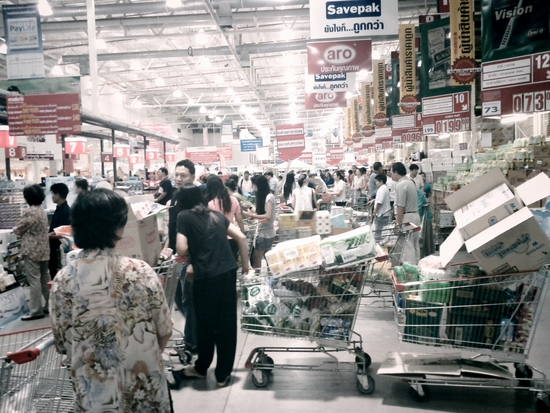 Bangkokians stock up on instant noodles at a warehouse store.