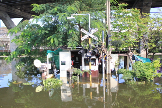 Flooded railway building near Don Muang Airport, Northern Bangkok.