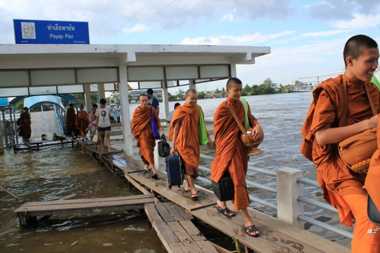 Monks transit a flooded Pier, Bangkok