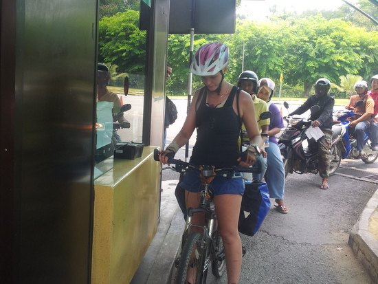 Crossing from Thailand to Malaysia by bicycle.