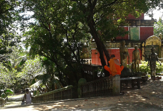 monk reading outside Wat Leu near Pagoda Rocks Boutique Resort, Sihanoukville Cambodia