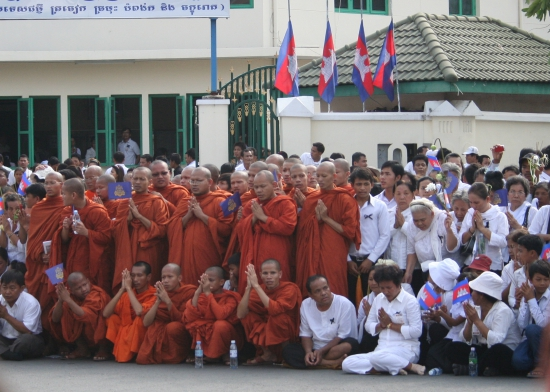 Monks lead prayers for waiting crowds