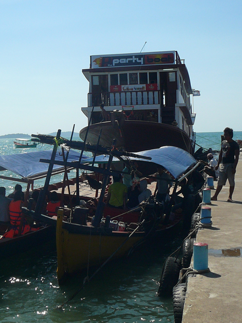 boats docked off serendipity beach pier, sihanoukville cambodia
