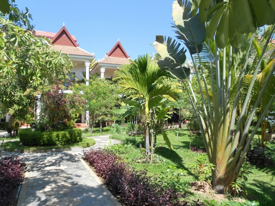 Meandering paths lead through lush tropical gardens at The Sonalong