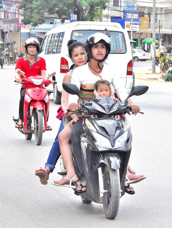 As in most of Asia, the humble moto doubles as a family saloon