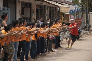 The kids from Sala Bai, with Sam McGoun who ran 625km across Cambodia to raise funds for the school. Makes buying a book look easy!