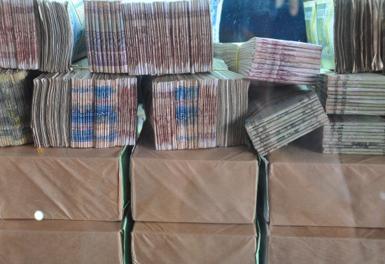 The Riel Thing: Wads of Cambodian cash await unwitting tourists.