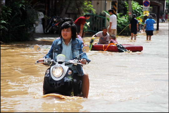 Scooters with flooded engines can be seen stalled on every street corner!
