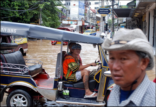 Tuk-tuk driver and partner had even put their 'songkran' gear on