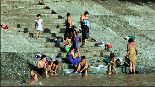 Many Mandalay residents still bath and do their laundry in the Irrawaddy