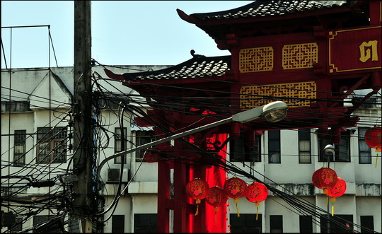 Thai electric cables with Chinese gate in background