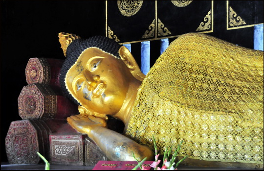 This reclining Buddha is sporting the winter collection