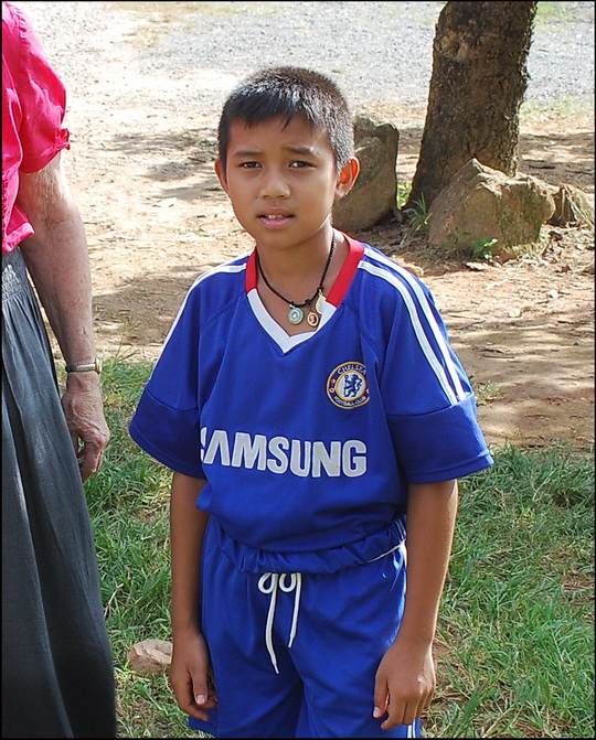 Hmong lad all dressed up in his Chelsea kit. Shame he's not wearing Chiang Mai FC colours though!