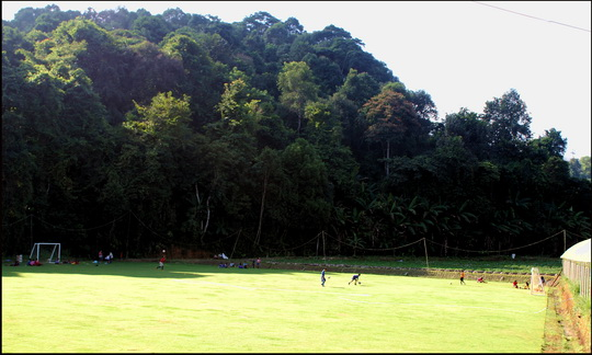 Jungle pitch - football's popular even in remote areas such as this mountain top Hmong village nr Chiang Mai