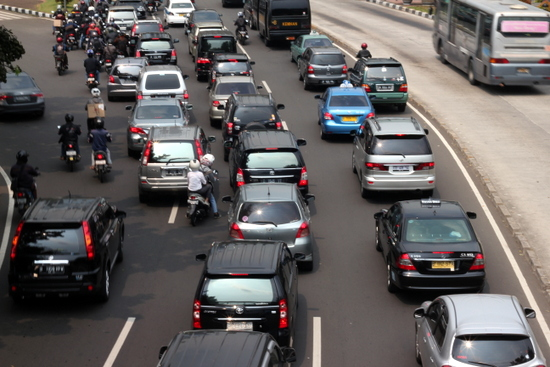 "Heavy traffic is the norm in Jakarta -- listen for the word ""macet"" meaning the road is jammed."