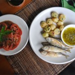 Crispy fried sardines served with garlic butter, pommes au beurre and tomato salad with balsamic vinaigrette. 68,000 rupiah.
