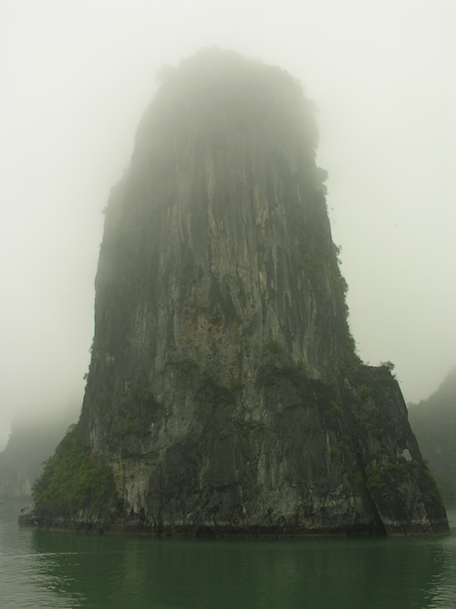 Dramatic karst islands like this one are far more numerous in Ha Long Bay.