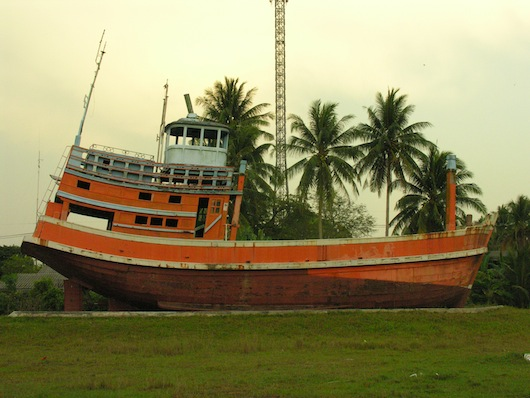 After being washed inland like a toy boat in a bathtub, this ship remains in the village centre.