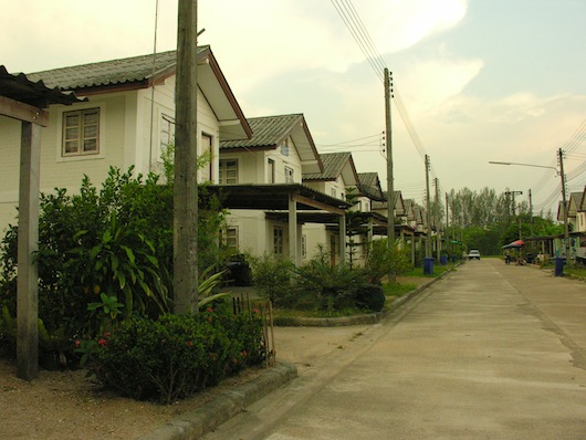 A rebuilt village serves also as a living memorial to the people of Nam Kem.