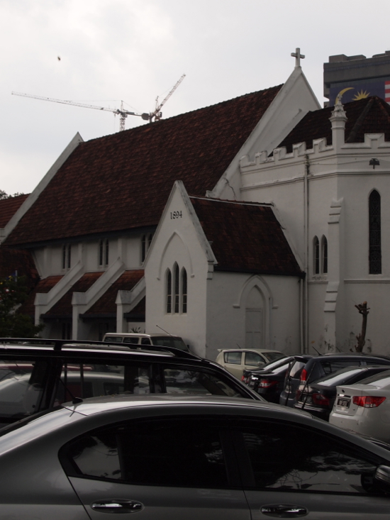 A car park with a 19th century church attached.