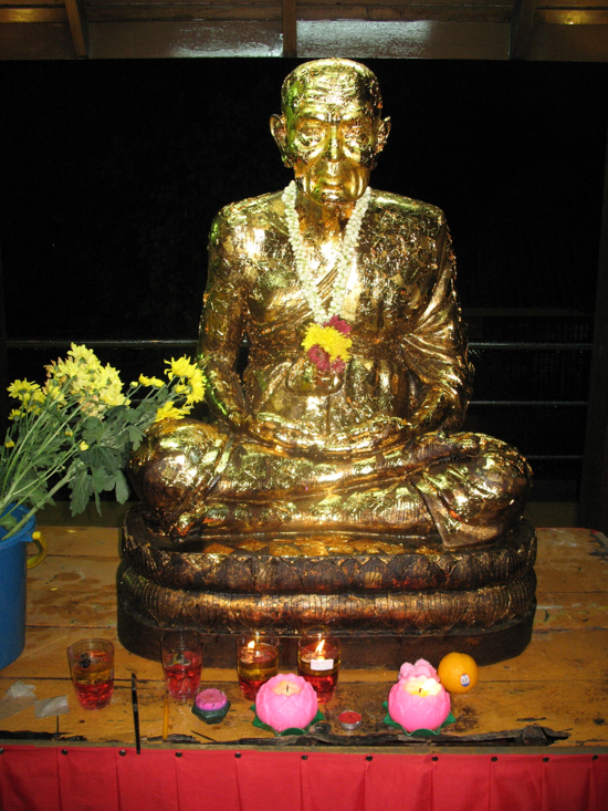 Buddhist statue adorned with gold leaf.