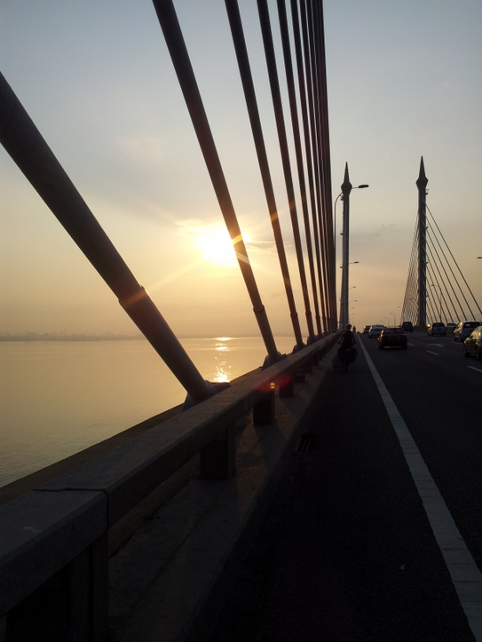 Sunrise over Penang Bridge.