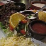 Order a mixed plate of beef and chicken fajitas, portions are generous and servings are tasty.