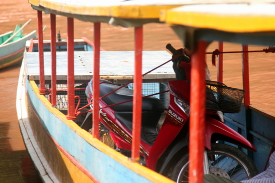 It's even possible to pop a motorbike on the boat from Hat Sa to Muang Khua