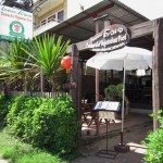 Cuisine D'or Vegetarian Restaurant offers a wide range of food and drink, and features outdoor seating with lush greenery.
