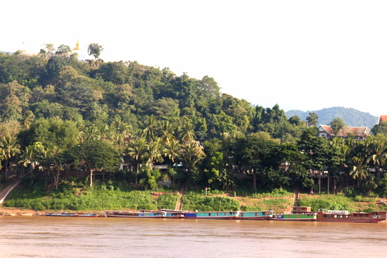 Catch the ferry to the other side of the river and go for a bike ride. Luang Prabang looks different from here.
