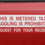 Despite what the sticker says, you will have to haggle for your Penang taxi