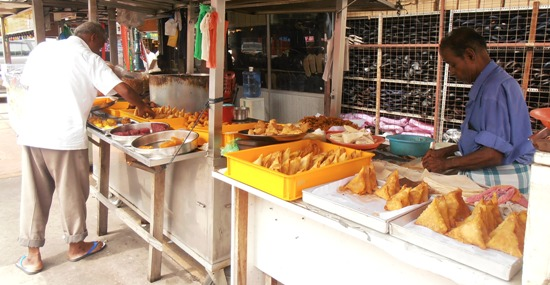 Fill up on delicious snacks at one of Little India's street stalls.