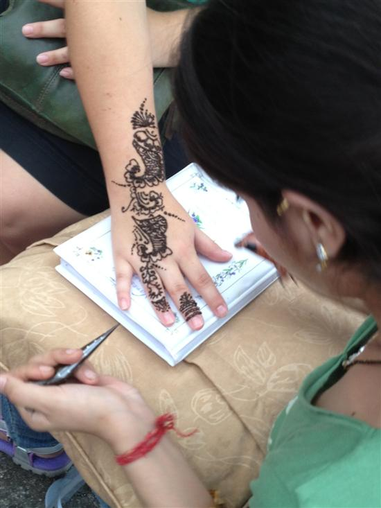 Stay still for your henna tattoo.