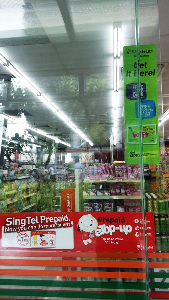 7-Eleven convenience stores sell prepaid mobile SIM cards.  This one sells SingTel and StarHub ones.