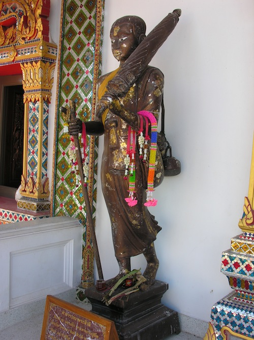 A depiction of a wandering thudong monk at Wat Phra Phrathat Choern Chumphon.