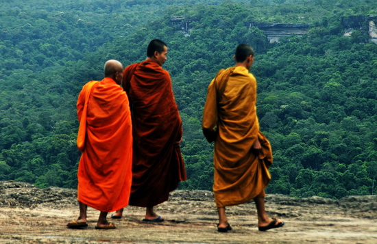 Monks checking out Laos from the cliff top at Pha Taem