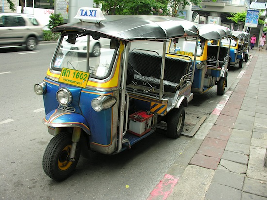 Classic blue and yellow Bangkok tuk tuks.