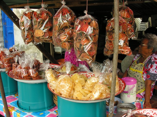 Look for these ladies selling dried and candied mathum at the entrance to Soi 23.