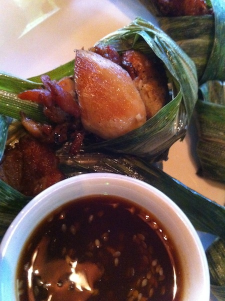 Chicken in pandan leaves -- out of the wrapper and into the sauce.