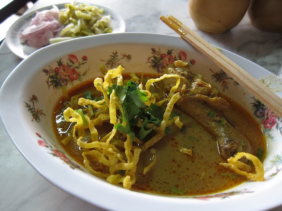 Rain tapping on the roof and khao soi -- it doesn't get much better than this.