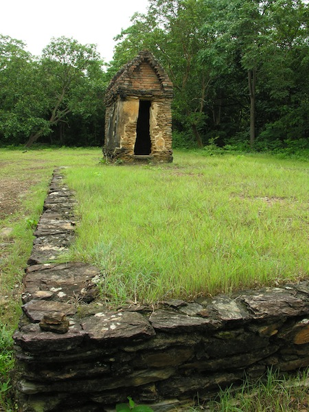 An eerie stone meditation hut at Wat Khao Phra Bat Noi