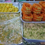 Royal India&#039;s specialty sweets on display outside.