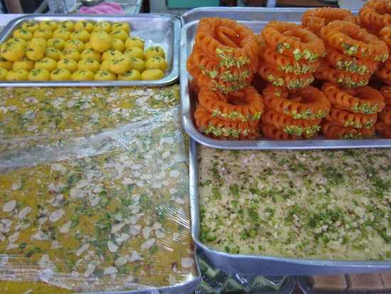 Royal India's specialty sweets on display outside.