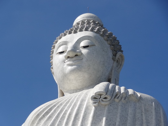 Big Buddha statue in a big blue sky.