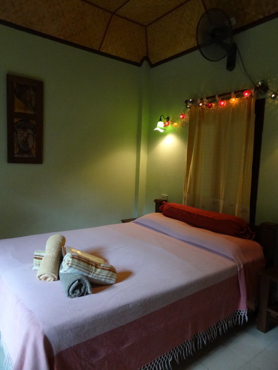 The Andaman Kitchen suite's cheerful bedroom.