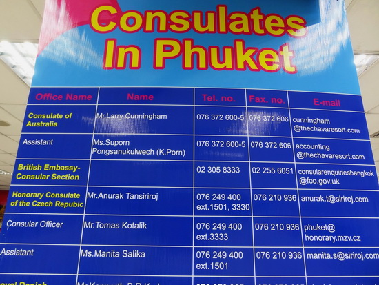 A list of consulates in Phuket seen at the airport baggage claim area.