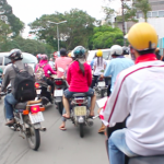 All the cool drivers in Saigon wear helmets.