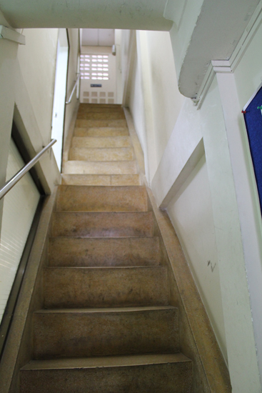 To get to the repair shop go through the iStore and up this narrow staircase.