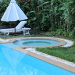 All tropical landscaped gardens and a jacuzzi!